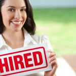 Attractive woman holding hired sign